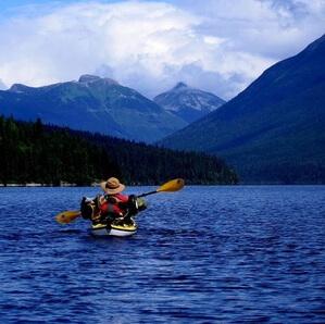 A person kayaking on Bowron Lake